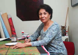 Lubna Agha painting a canvas c. 2010